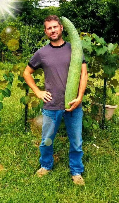 Pauly with the cucumber grown with worm composting tea